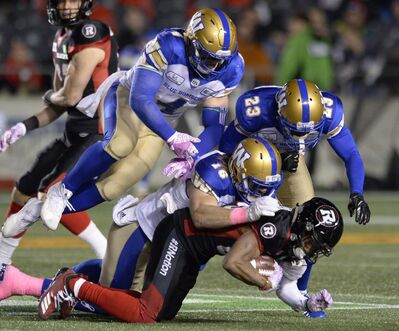 Adrian Wyld / THE CANADIAN PRESS FILES</p><p>Winnipeg Blue Bombers defensive backs Taylor Loffler, Adam Bighill and Anthony Gaitor bring down Ottawa Redblacks wide receiver Diontae Spencer last Friday in Ottawa. The Bombers defence surrendered 437 net yards in the 40-32 overtime win.</p>