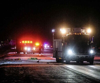 Emergency crews clean up while RCMP investigate at the scene of the accident on Route 90 near the North Perimeter highway Friday evening.