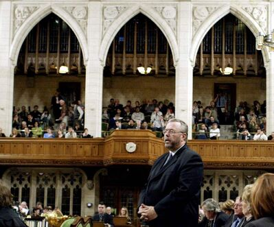 Reg Alcock responds  to a question in Ottawa Oct. 12, 2004 in his role as Treasury Board president.