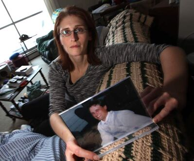 Corinne Staple holds a picture of her brother, Brent, last year. He contacted her this week.