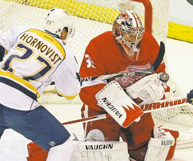 Kirthmon F. Dozier / Detroit Free Press / MCTRed Wings goalie Jimmy Howard makes a save against the Nashville�s Patric Hornqvist during first-period action in Game 4 Tuesday.