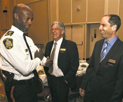 Chief Devon Clunis chats with Darren Klassen (right), chairman of the Building Owners  and Management Association, and Tom Skraba before his speech at the Delta Winnipeg Hotel.