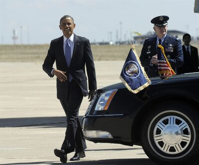 President Barack Obama walks to greet people after arriving at Buckley Air Force Base in Colo.,Wednesday, April 3, 2013. Obama is meeting with local law enforcement officials and community leaders to discuss the state's new measures to reduce gun violence. (AP Photo/Susan Walsh)