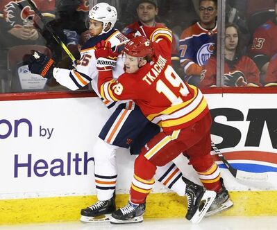 Edmonton Oilers' Darnell Nurse, left, gets attention from Calgary Flames' Matthew Tkachuk during first period NHL hockey action in Calgary, Alta., Saturday, Jan. 11, 2020. Matthew Tkachuk tried to pour cold water on his feud with Zack Kassian. It didn't really work. After not speaking to reporters Wednesday, the Calgary Flames' star forward and resident agitator made it clear 24 hours later he once again wouldn't answer questions concerning the continued fallout from Saturday's heated game with the Edmonton Oilers. THE CANADIAN PRESS/Larry MacDougal