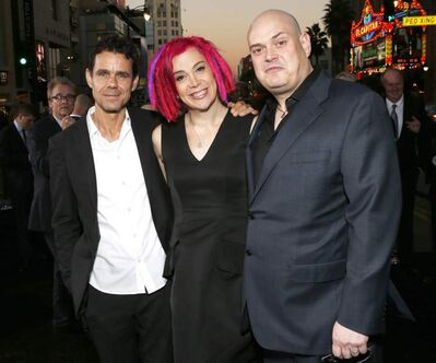 "Co-directors Tom Tykwer, Lana Wachowski and Andy Wachowski pose for reporters at the Los Angeles premiere of ""Cloud Atlas"". The Wachowskis, who directed Keanu Reeves in the Matrix trilogy, are fans of digital video technology."