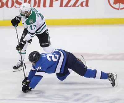 Winnipeg Jets' Patrik Laine (29) gets tangled up with Dallas Stars' Alexander Radulov (47) during first period action in Winnipeg, Monday, March 25, 2019. Trevor Hagan / The Canadian Press