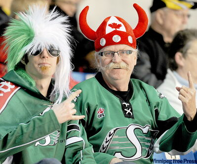 Regina duo Rorie Dickie, left, and his dad Gale are breathing new life into curling as a spectator sport. In a city of 12,0000, Swift Current is making the World Championship a roaring success.