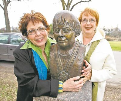 Deborah Schnitzer, left, and Marjorie Anderson with bust of author Carol Shields.