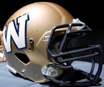 FULL CLOSE CUT CLOSECUT - The new Winnipeg Blue Bombers 1980s-style logo is unveiled at a press conference at Canada Inn Stadium in Winnipeg, Tuesday, April 24, 2012. The CFL club is changing its helmet logo back to a simple 'W'. THE CANADIAN PRESS/John Woods