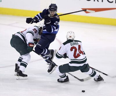 TREVOR HAGAN / WINNIPEG FREE PRESS</p><p>Winnipeg Jets&#39; Nikolaj Ehlers narrowly avoids a hit by Minnesota Wild&#39;s Jonas Brodin and Matt Dumba during second period, Wednesday.</p>