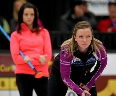 Runner-up Kerri Einarson (left) watches winner Chelsea Carey during the final of the Scotties Provincial Curling Championship in Virden.