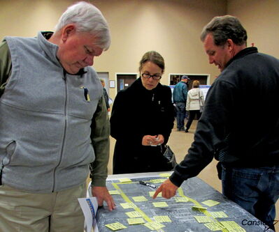 Community members were encouraged to use sticky-notes to mark their areas of concern.