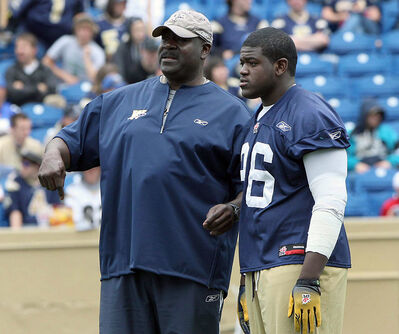 Winnipeg Blue Bombers assistant head coach Richard Harris talks to Dashawn Cassell during training camp in June. Harris died at age 63 on Tuesday.