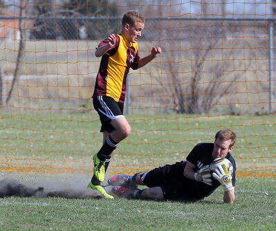 Brandon Sun Neelin keeper Theo Farough dives on the ball during a high school soccer match at Crocus Plains. Farough was named as he 2013 overall Manitoba Male Jostens High School Athlete of the year.