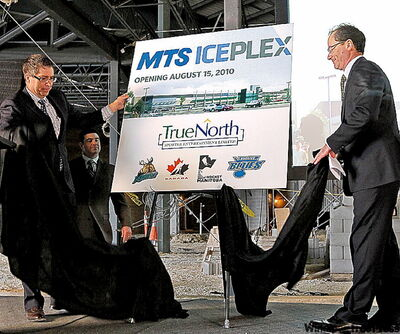 MTS Allstream's Kelvin Shepherd, left, and Jim Ludlow, president and CEO of True North, unveil the new name of the MTS Iceplex.