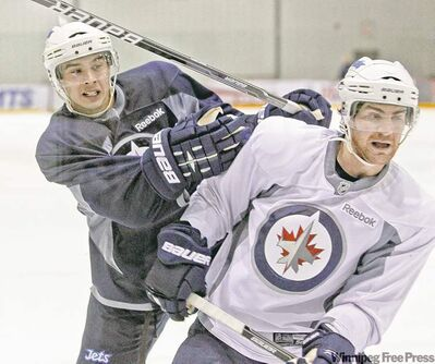 Tim Stapleton (left) and Jim Slater didn�t take the easy way out at Wednesday�s practice. The team went at it hard.