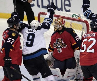 Winnipeg Jets' Evander Kane (9) celebrates after scoring the tying goal, 3-3, against Florida Panthers goalie Jose Theodore (60) in the third period of an NHL hockey game in Sunrise, Fla., Monday.