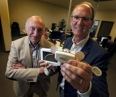 PHIL HOSSACK / WINNIPEG FREE PRESS</p><p>Earl Gardiner (right), CEO of Cerebra Health Inc., holding an in-home sleep disorder diagnostic device called Prodigy, poses with Dr. Magdy Younes, who has invented breakthrough diagnostic technologies for sleep disorders.</p>