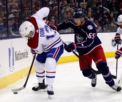 Montreal Canadiens forward Max Domi, left, controls the puck against Columbus Blue Jackets defenseman Markus Nutivaara, of Finland, during the first period of an NHL hockey game in Columbus, Ohio, Friday, Jan. 18, 2019. (AP Photo/Paul Vernon)