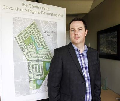 Dave Boles, development manager for Genstar Development Company, with site-development drawings for one of  the major developments for the neighbourhood 'where we got our start.'