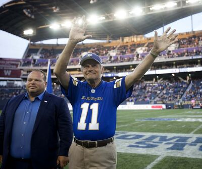 RUTH BONNEVILLE / WINNIPEG FREE PRESS</p><p>All-star quarterback Ken Ploen, who started with The Winnipeg Blue Bombers in 1957, was inducted into the Ring of Honour with Bomber CEO Wade Miller during halftime of the Bombers&#39; game against the Edmonton Eskimos at Investors Group Field Thursday night. </p>