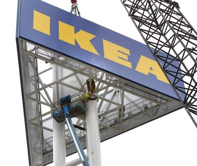 A giant IKEA sign is installed in front of the Winnipeg store on Kenaston Boulevard.