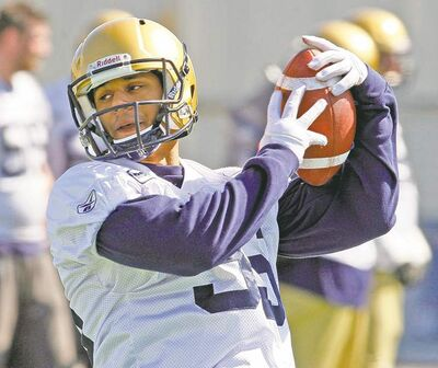 KEN GIGLIOTTI  / WINNIPEG FREE PRESSAnthony Woodson makes a catch during Blue Bombers mini camp at Canad Inns Stadium on Thursday.
