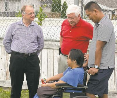 Melissa Tait / Winnipeg Free PressBob Axworthy (left) and federal Liberal Leader Bob Rae (centre) speak with Fort Whyte residents.
