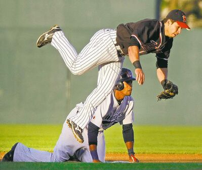 Fargo-Moorhead's Carlo Cota is upended at second base by Winnipeg Goldeye Chris Roberson on Wednesday night.