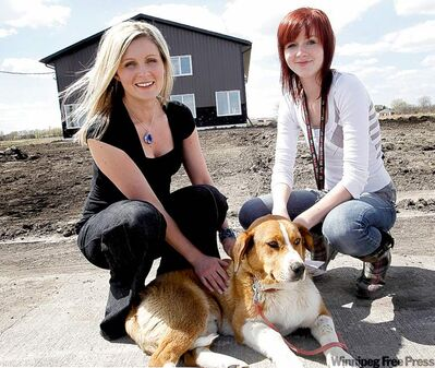 Michelle Frost (left) with Chili, who was shot through the neck. Erin Ginter (right), adoption co-ordinator, took in a dog that had container of rocks tied to it.