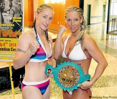 "Challenger Brooke ""No Mercy"" Dierdorff Millbrook and champ Olivia ""The Predator"" Gerula strike a pose at Wednesday's weigh-in."