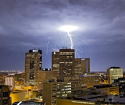 Lightning brightens the downtown sky on Friday.