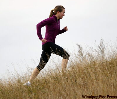 U of M's Katrina Bruckschwaiger runs uphill as she trains for an Edmonton meet Oct. 31 and the CIS championship Nov. 14.