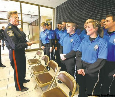 Winnipeg police Chief Keith McCaskill talks to the first graduating class of 29 police cadets at city hall last month. Cadets have been patrolling downtown since last year, freeing up officers by handling routine police duties such as guarding crime scenes or directing traffic.