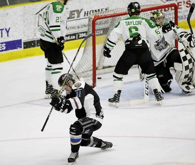 Swan Valley Stampeders' Kasyn Kruse celebrates scoring on Portage Terriers goaltender Ethan Peterson in first period of game five playoff action in Portage La Prairie Tuesday.