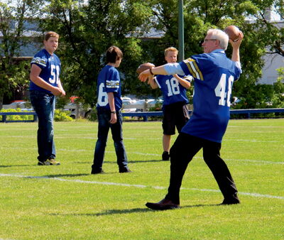 Manitoba Premier Greg Selinger announced $400,000 to local projects in southwest Winnipeg. The Fort Garry Lions football field is one of the receipts of the funding that will go towards new lighting for the field. After the announcement the premier threw some pigskin with the some of the Bantam Lions football team.
