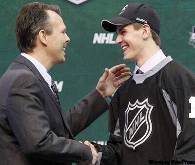 General manager Kevin Cheveldayoff shakes hands with first round pick Mark Scheifele at the 2011 NHL hockey draft in St. Paul, Minnesota,  June 24, 2011.