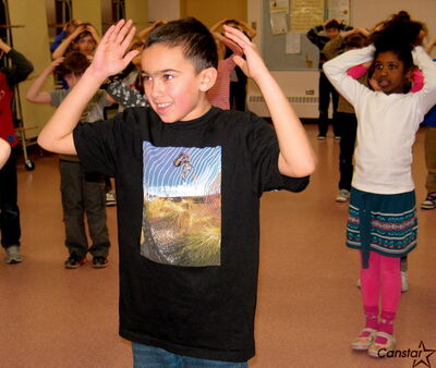 Students at Robert H. Smith School play a game of Simon Says with their artist in residence, Brenda Gorlick.