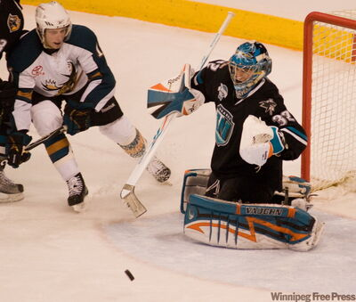 Manitoba Moose Matt Pope (10) looks for the shot against Worcester Sharks goaltender Alex Stalock (32) during second period action at the MTS Centre Tuesday night.