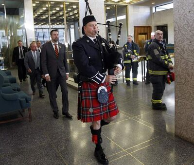 National Day of Mourning was observed at Winnipeg City Hall as police, firefighters, paramedic and city workers gathered and offered a minute of silence. The group of city and provincial dignitaries  were piped in by Winnipeg Police Pipe Band piper Rick McDougall.