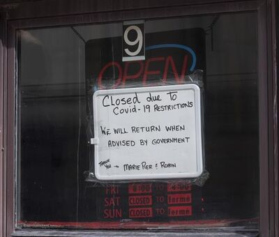 A sign in a barber shop window indicated the establishment was closed because of COVID-19 in Ottawa, Wednesday, March 18, 2020. A new poll suggests that there are people in this country who believe that warnings from public officials about the threat of COVID-19 are overblown, but also that many expect the country to return to some form of lockdown. THE CANADIAN PRESS/Adrian Wyld