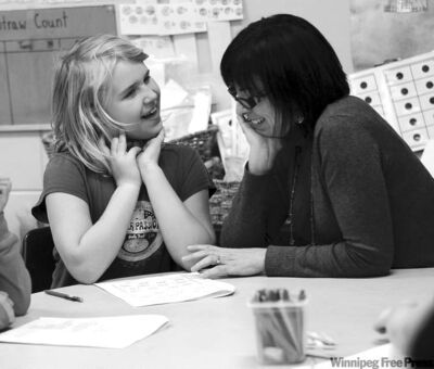 Forrest Park School teacher Sabrina Slessor, with Grade 3 student  Tia Collins, uses visual devices such as cards, beads and string to teach math concepts.