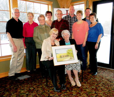 These Macdonald residents were honoured for their volunteer contributions. Back row (left) Larry Manson, Rita Lavoie, Patsy Andrews-Vert Jon Magarrell, Brad Erb; middle row (left) Joyce Dusik, Rudy Dusik, Jen Magarrell, Lynne Elke; seated (left) Janis McMorran, Isobel Cuddy.