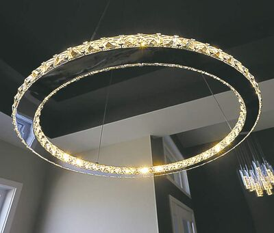 A circular chandelier hangs from the centre of the double-tray ceiling in the dining room.