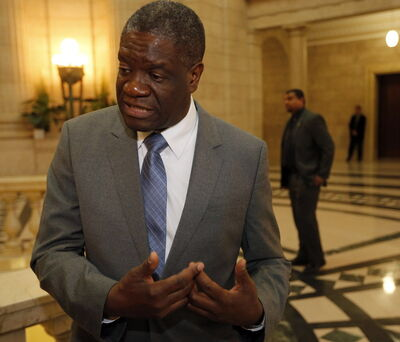 Dr. Denis Mukwege speaks at the Manitoba legislature surrounded by private security Monday.