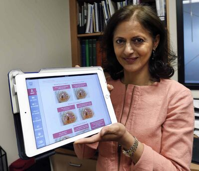 U of M-trained Dr. Sandhya Pruthi demonstrates the breast cancer patient app she helped develop for the renowned Mayo Clinic.