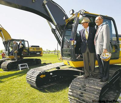 Developer David Asper (left) and Blue Bombers chairman Bill Watchorn take part in sod-turning for new stadium in May.