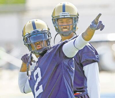 Blue Bomber Jovan Johnson does his best Usain Bolt impression while fellow defensive back Johnny Sears looks on during the team's practice at Canad Inns Stadium on Tuesday.