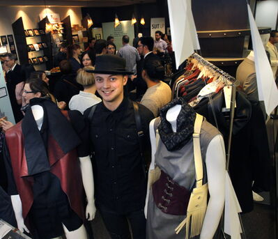 Fashion designer Lennard Taylor with clothes he has manufactured on display at Portage Place.