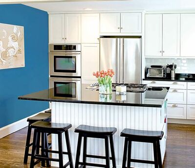 The bold CIL colour on the wall, called Blazer Blue, looks stunning against the white cabinets and baseboards.